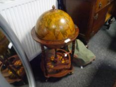 A vintage standing world globe cocktail cabinet