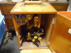 An early 20th century W. Watson & Sons Ltd lacquered brass microscope, Edinburgh model, with