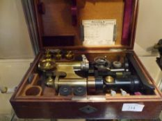 An early 20th century E. Leitz Wetzlar lacquered brass microscope in a fitted mahogany case,