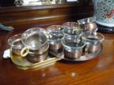 A Schott & Gen Mainz copper mounted six cup set each with rattan handle on copper tray c. 1970s,
