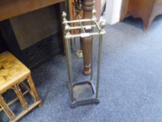 An Edwardian brass and cast iron stick stand with original liner