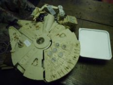 A Kenner Star Wars Millenium Falcon Lucas Films Star Wars model and group of Star Wars figures
