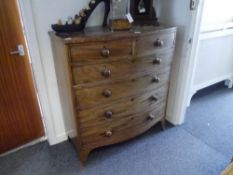 A Victorian mahogany bow fronted chest of drawers with two short over four long drawers, on