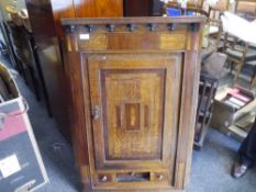 A 19th century inlaid and crossbanded oak hanging corner cabinet