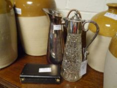 A white metal jug with leather handle, a silver plate mounted moulded glass claret jug, and six