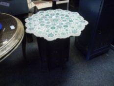 An Indian inlaid marble topped carved wooden fretwork folding occasional table