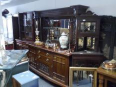 A mirror backed mahogany sideboard, c 1900, bowfronted, with dentilled cornice and carved foliate
