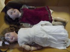 Two German bisque head dolls, early 20th century, one marked Germany 200 the other unmarked, both