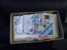 A box with envelopes and packets of World stamps