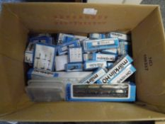 A box containing approximately forty boxed Marklin HO gauge rolling stock including car transporter,