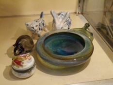 A group of ceramics and glass including two Russian blue and white glazed animal models, a studio