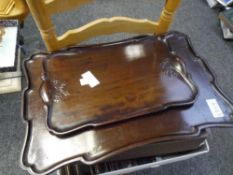 Two Oriental moulded and carved hardwood trays
