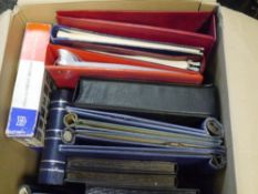 A box of empty binders and stock books (33)