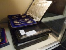 A George V cased set of twelve silver teaspoons with tongs Sheffield 1916 together with a cased