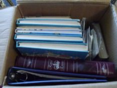 A box with assorted junior stamp albums with duplicates
