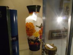 A cased glass vase in the manner of Galle decorated in orange and brown against an opaque ground and