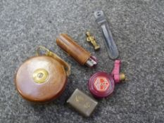 Three vintage tape measures including a surveyors leather bound 33ft, a bakelite cased, and a late