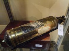 A vintage Gacos brass fire extinguisher