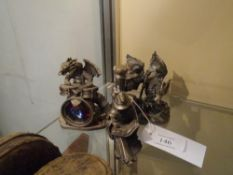 "A group of three pewter fantasy figures by WAPW UK including ""Lets Go Man"" and ""Water Dragon"" (3)"