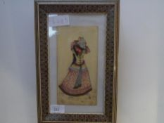 An Indian watercolour on ivory wafer, of a female water carrier, in an inlaid frame