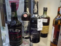Four bottles of vintage port comprising Dows 1963, Porto Messias 1963, Taylors White. and Offley Boa