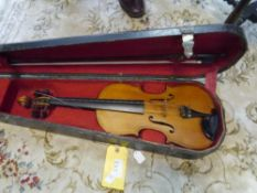 A full size violin, probably German, of Maggini type, with two piece back and cased with bow 38cm