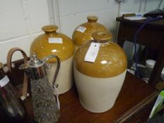 A group of three small salt glazed stoneware flagons comprising: P & CSS Associates Ltd Edinburgh;