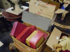 Three boxes containing a quantity of Hornby railwayana including boxed carriages and associated