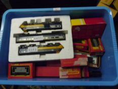 A group of Hornby and Tri-ang boxed 00 gauge diesel locomotives and rolling stock