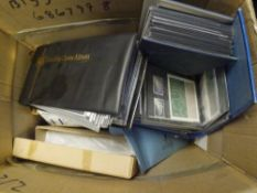 A box containing a very large collection of Royal Mail GB First Day Covers, loose and in albums