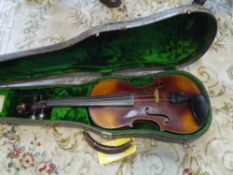 A German violin, c 1900, with spurious Stradivarius label, two piece back and lion-head carved