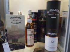 A group of five malt and blended whiskies comprising: Glefiddich Excellence 18 years; Bowmore Enigma