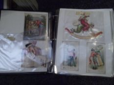 An album of Victorian Edwardian and later Christmas, New Year and other Greetings cards, together