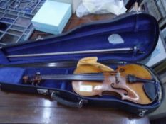 """A 19th century full size violin, the back stamped """"Stainer"""" bearing paper label """"Jacobus Stainer"""
