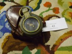 A World War I brass prismatic compass Verners Pattern VIII with arrow mark and dated 1917 in a