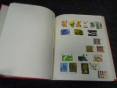 An album of GB used commemorative stamps including a £10 stamp (41)