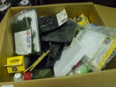 A box containing a quantity of raliway modelling craft materials including landscape moulds,