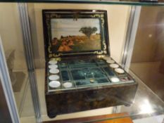 A mid-Victorian mother of pearl and abalone inlaid coromandel workbox, the cover decorated with a
