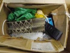 A box containing a quantity of Marklin HO gauge track together with railway bridge, signal etc