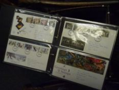 Two albums of approximately 150 GB Post Office and Royal Mail First Day Covers 1980-97 including