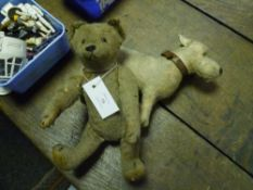 An early 20th century straw-stuffed teddy bearl, probably German, with growler (a/f) together with a