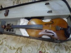 A full size German violin of Guarneri type, two piece back, cased 37.5cm