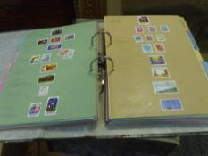 A collection of world stamps in two file folders (49)