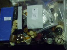 A box containing a quantity of plastic, faux horn and other buttons together with a bag of