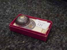 A silver jockey cap caddy spoon, Sheffield 1969, in its original cardboard box