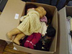 A box of vintage dolls including Sarold costume dolls etc