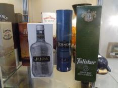 A group of five malt and blended whiskies comprising: Tormore 12 years; Jura 10 years; Talisker 8