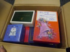 A box with a few albums and duplictated GB stamps in small boxes (35)