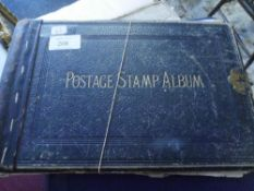 An old album with stamps historical cut outs matchbox covers
