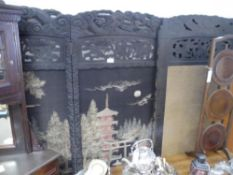 A 1920s Chinese hardwood and silk four panel screen, the panels worked with a pagoda and other